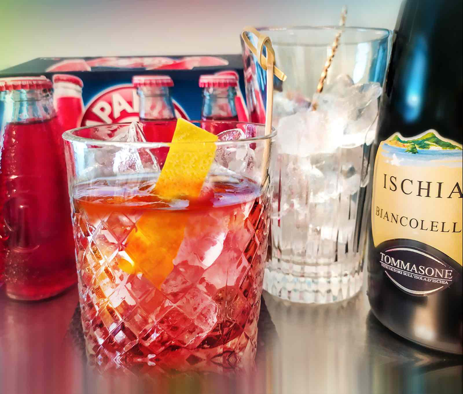 Ready, steady, stir the Iskian Negroni; Mix Biancolella white wine and soda, add tonic water and garnish with lemon.