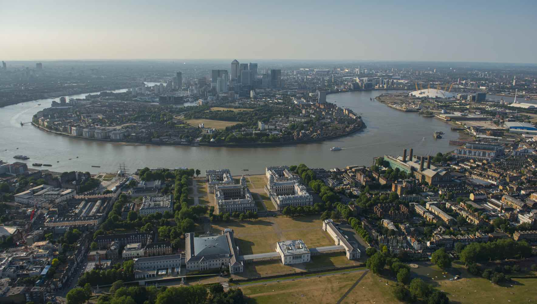 View over London, the River Thames and the historic buildings and parks of Greenwich. The Old Royal Naval College, maritime Greenwich heritage site