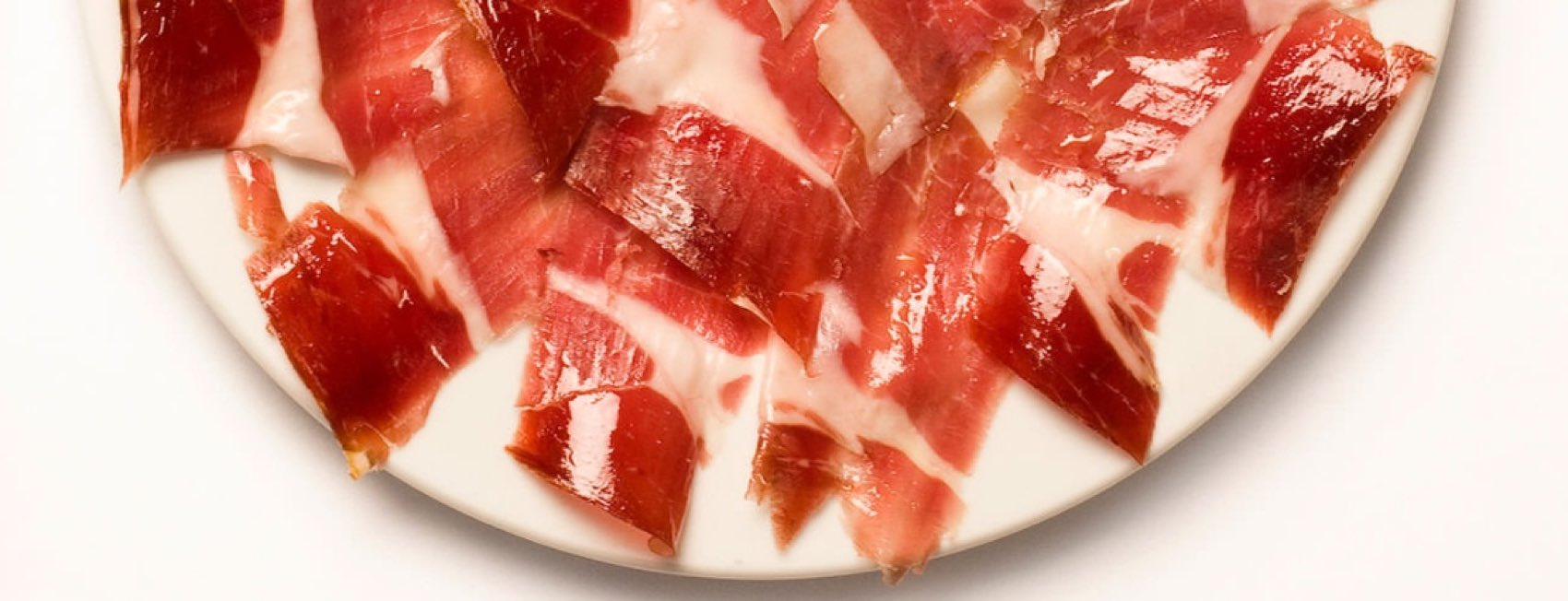 Jamón Ibérico is made from farm-raised, usually crossbred Ibérico pigs that are raised indoors.