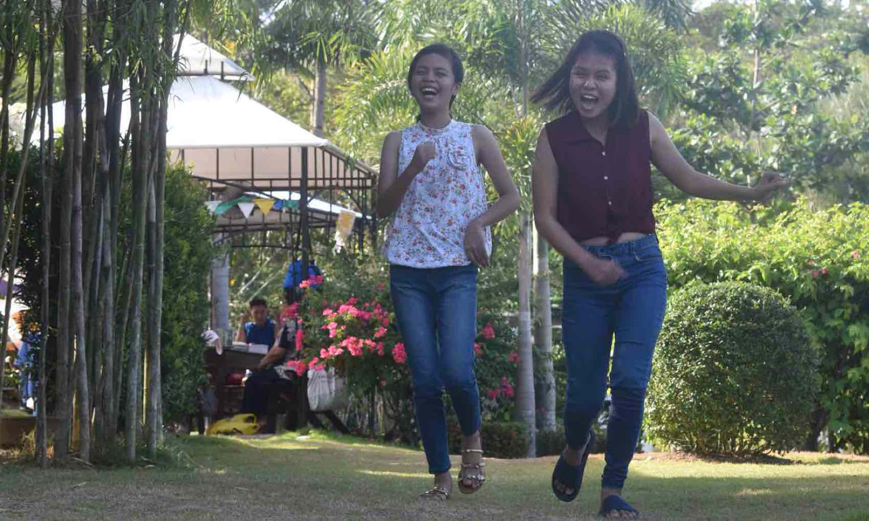 Mostly the people of Philippines are happy - as these two girl in city of Tacloban