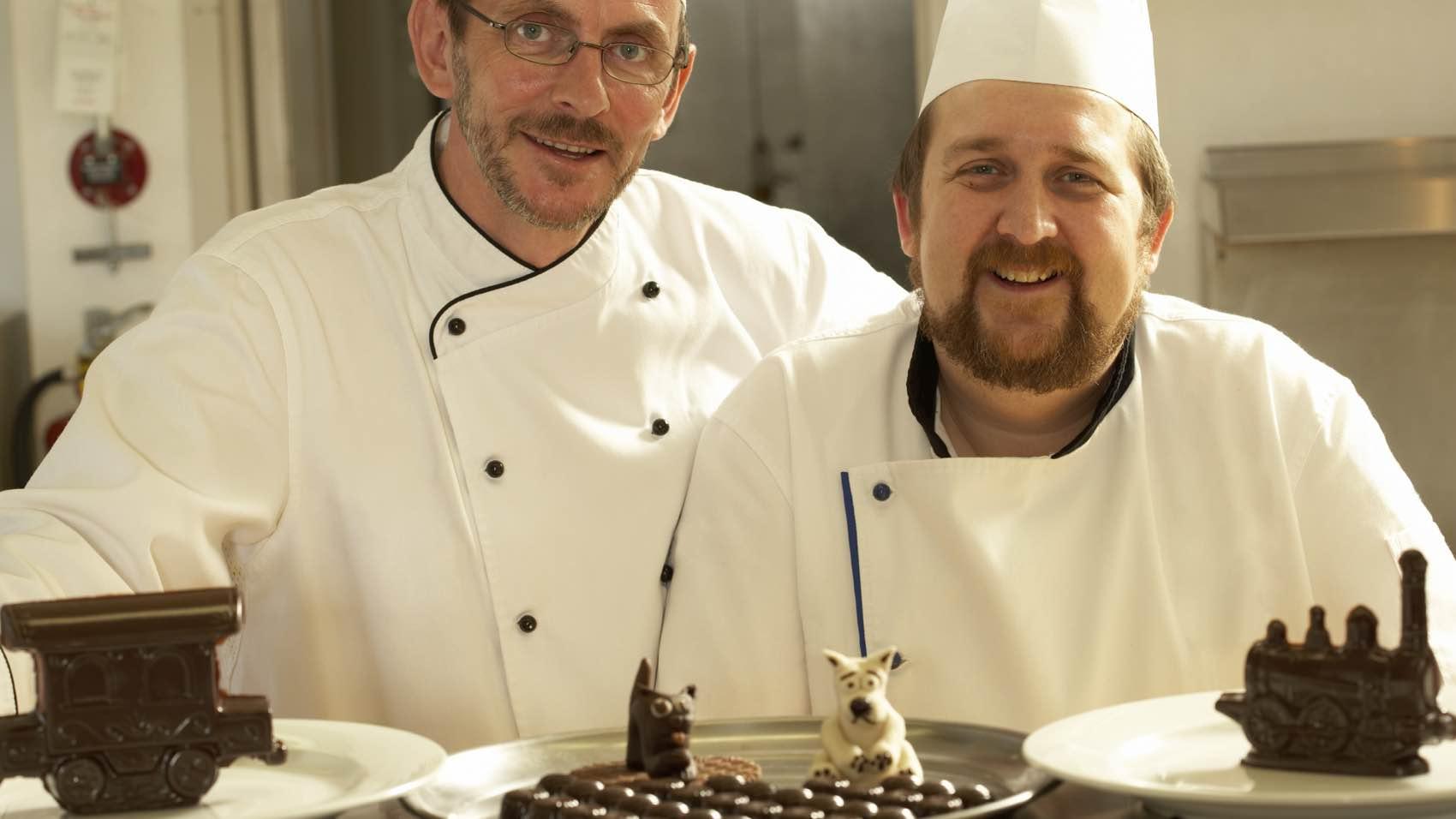 Men at work: Two cake Decorists