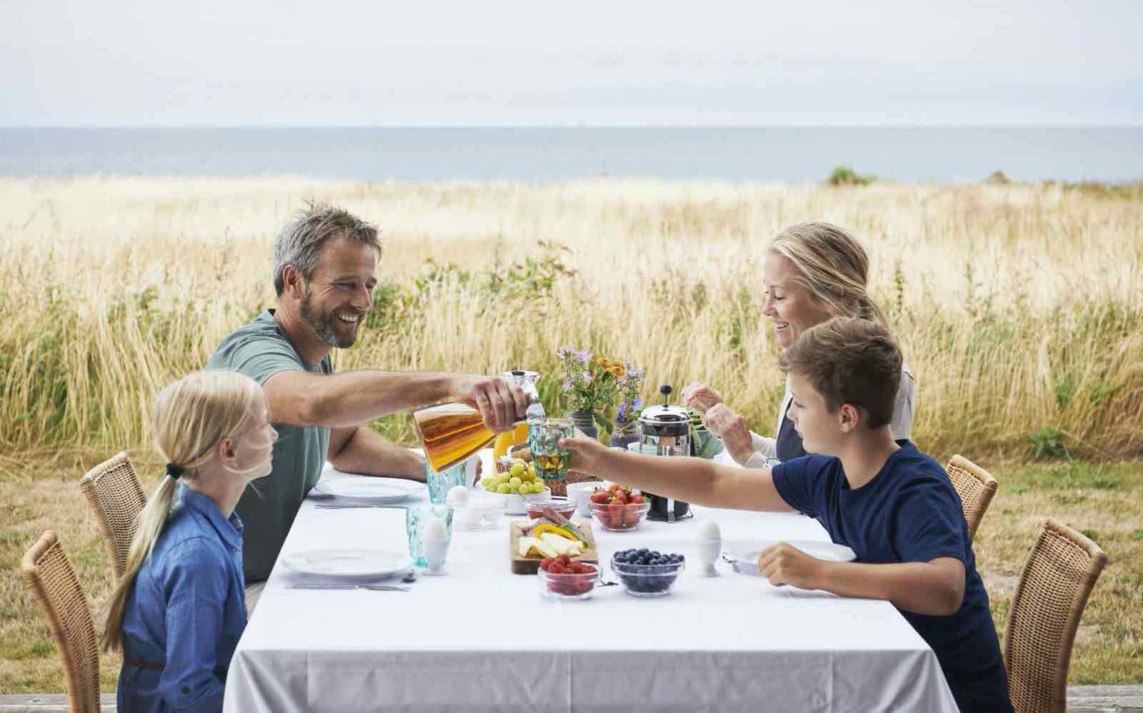 Outdoor breakfast for a Danish family at the seaside