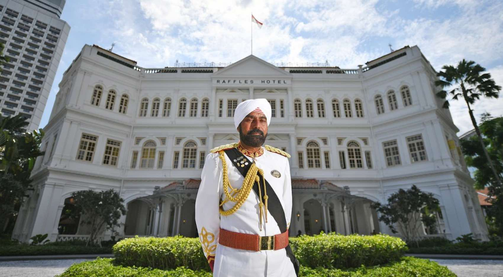 Narajan Singh and two other Sikh doormen of Raffles Hotel are the brand ambassadors of the grand old institution.