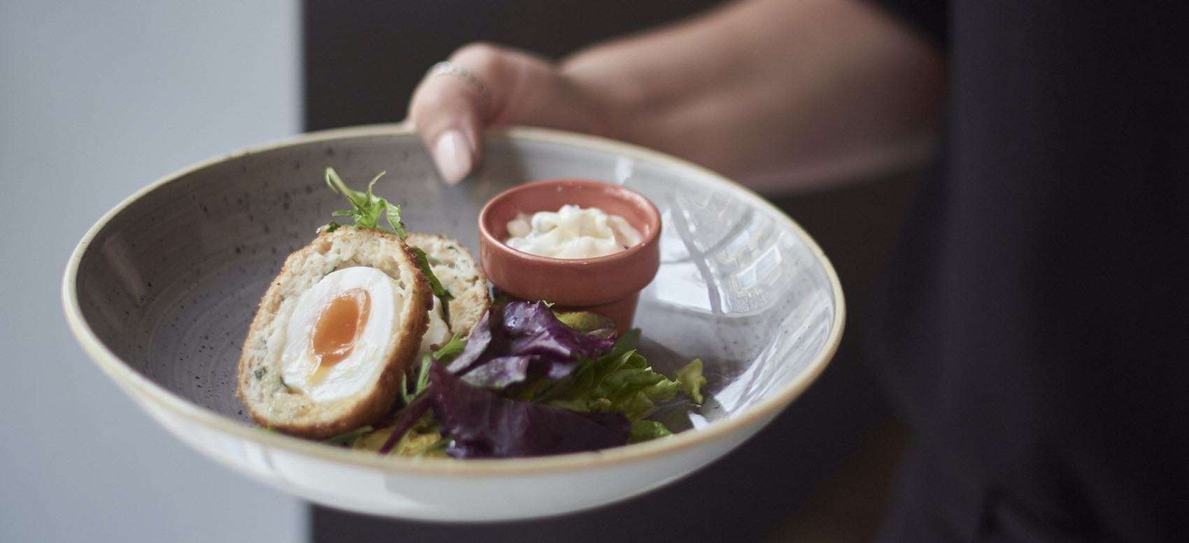 A plate with potted lobster and Scotch Egg at The Potted Lobster, Bamburgh, Northumberland.