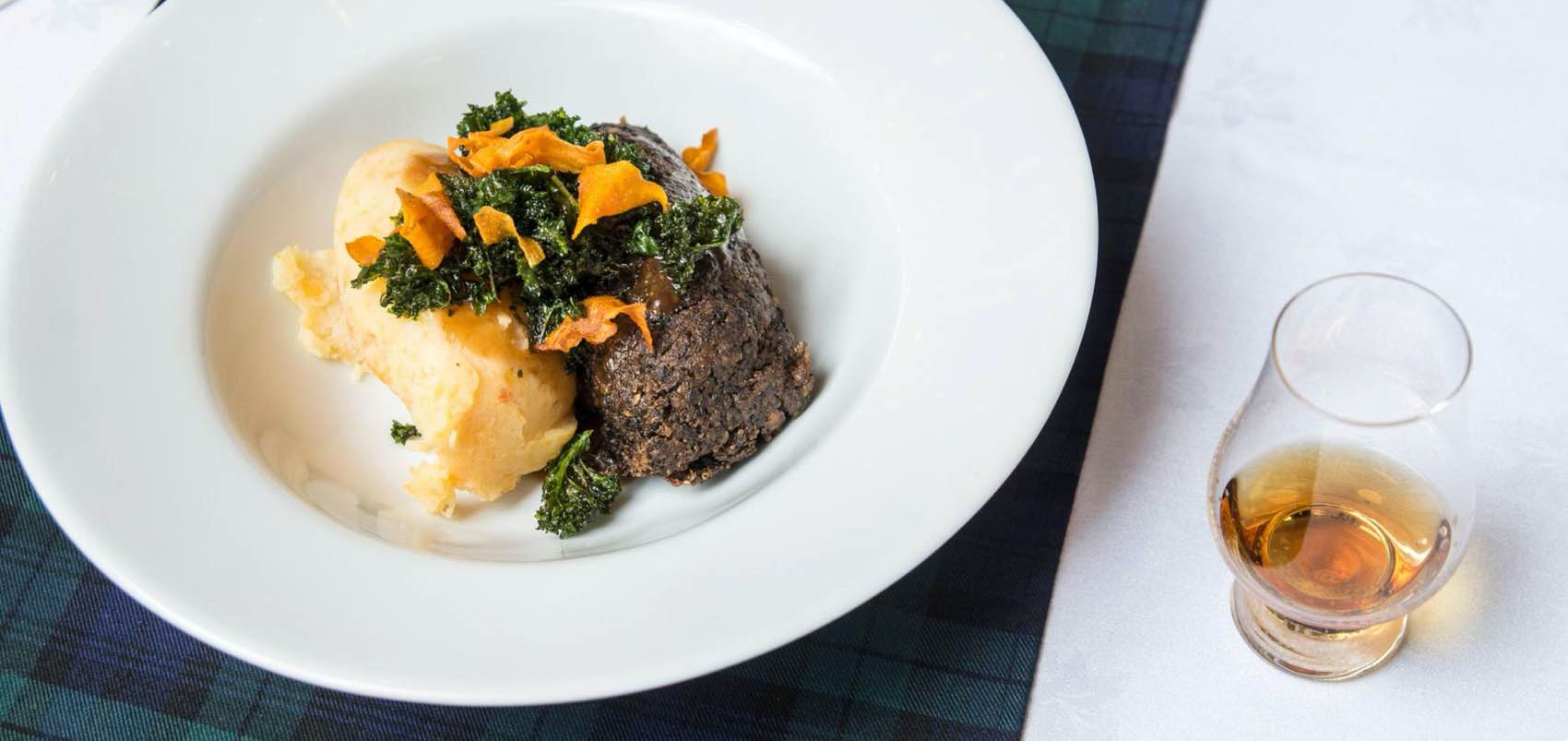National specialities: Haggis and whisky served in Scotland