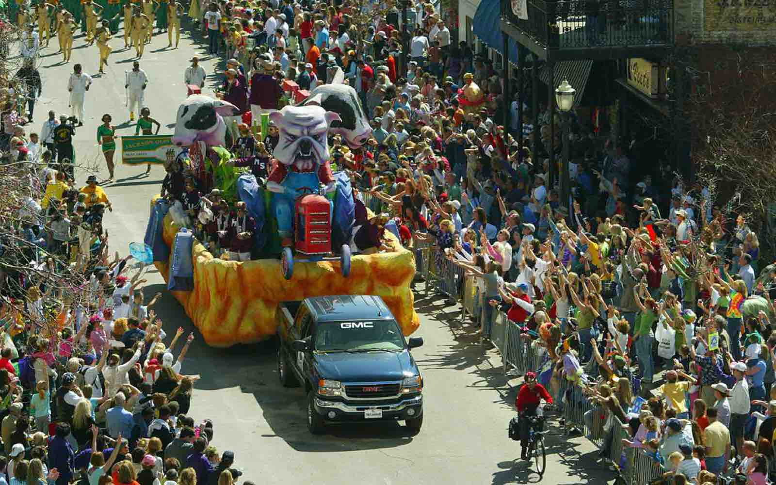 """Spectators line Royal Street as the """"Mississippi State"""" float in the Knights of Revelry parade passes in downtown Mobile."""