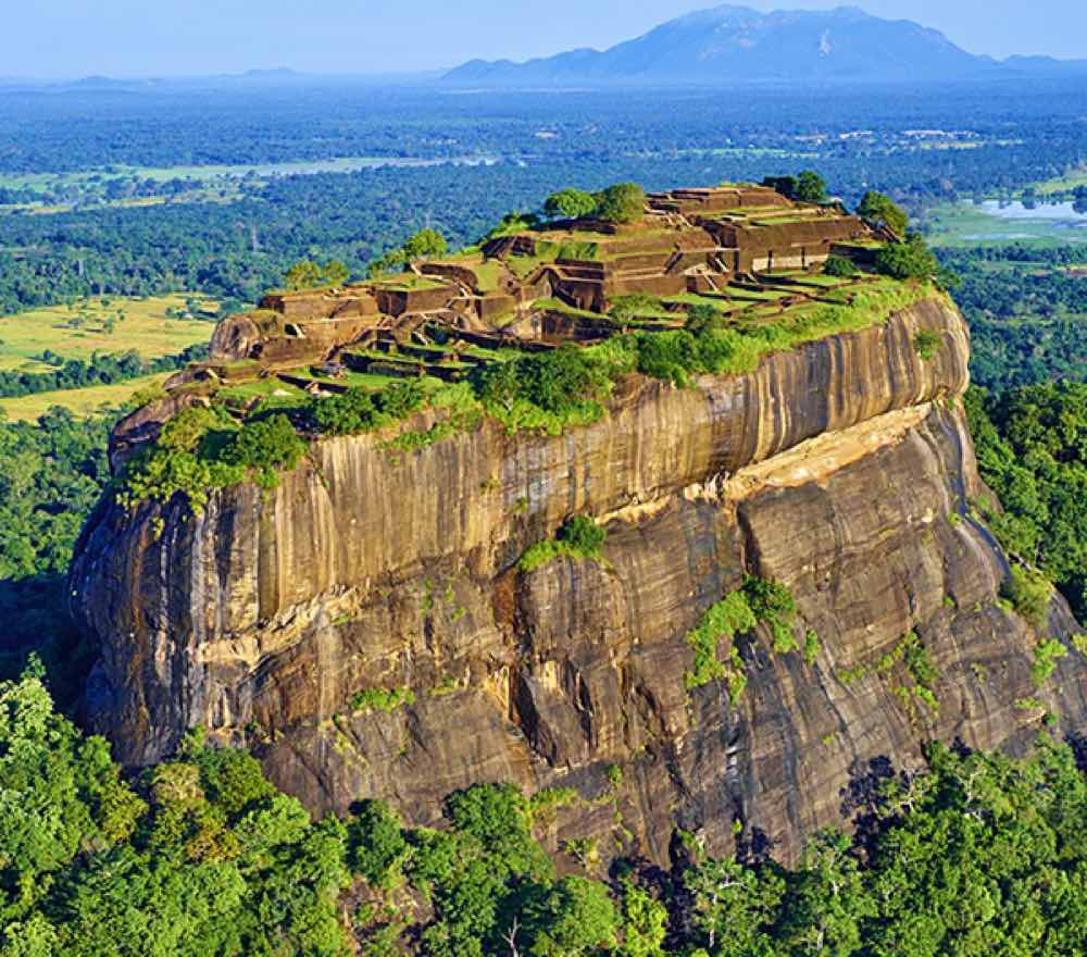 The famous Rock, surrounded by a network of gardens. 169km from capital Colombo