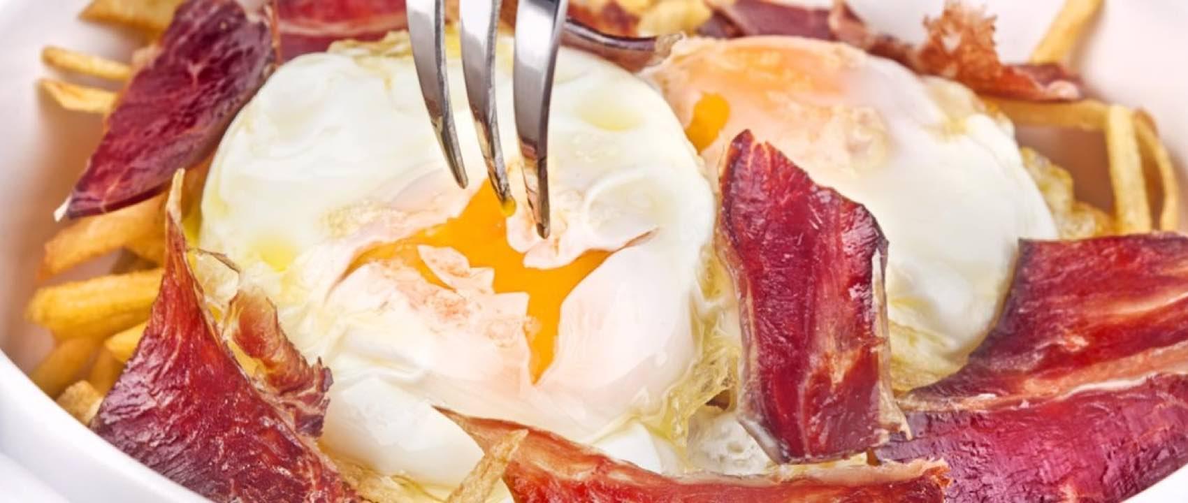 This is Huevos rotos, dip bread into the egg yolk.