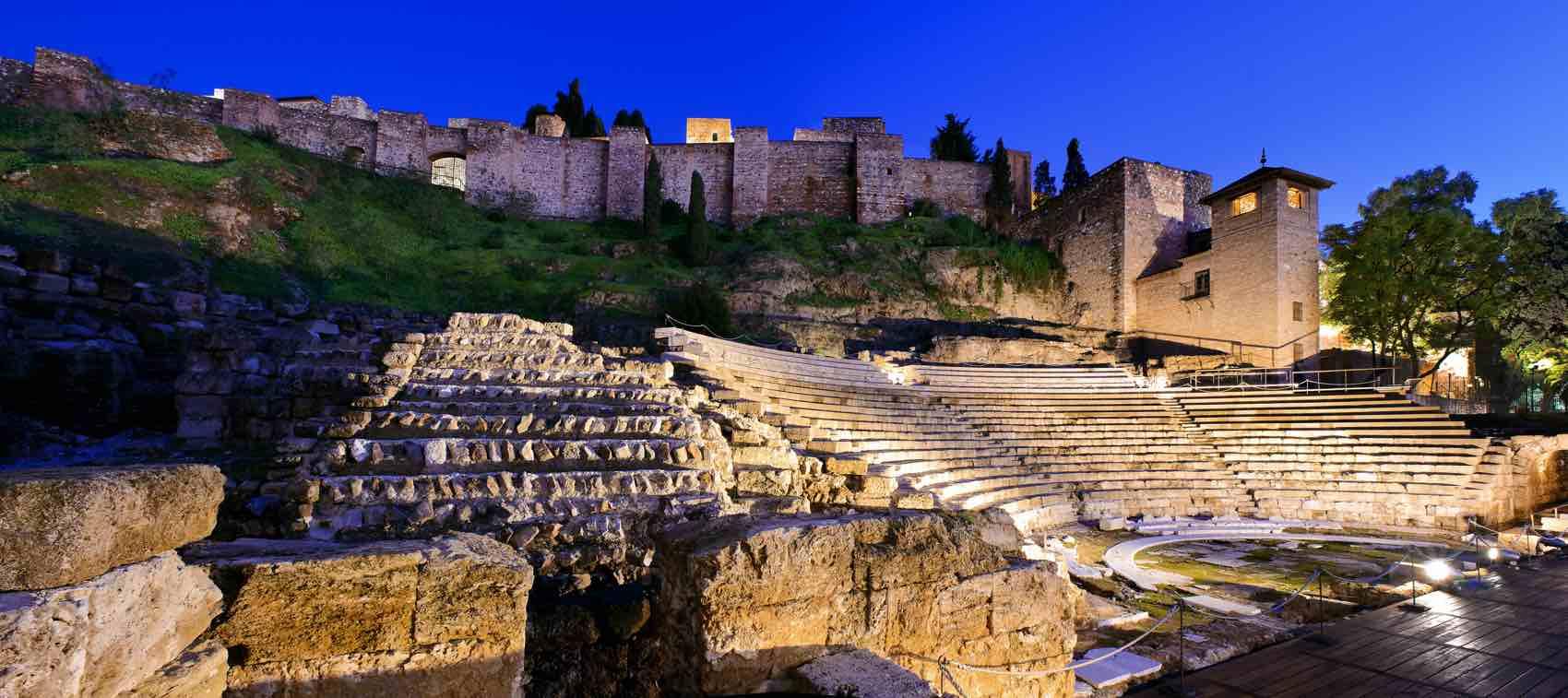 The Moorish Alcazaba fortress overlooking the city's restored Roman Amphitheater.