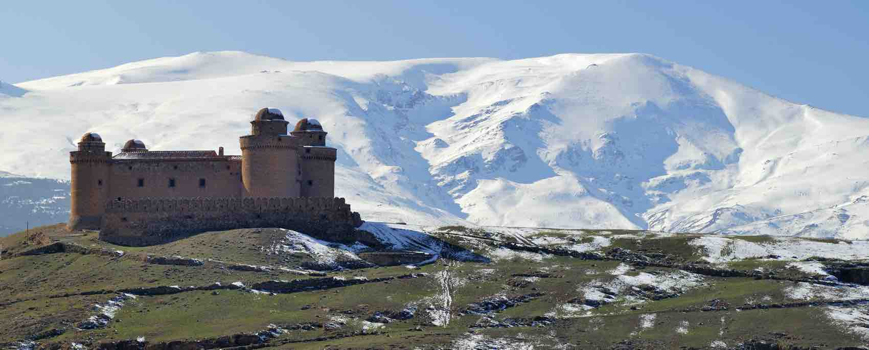 The imposing fortress of Calahorra, near the snowy mountain of Sierra Nevada