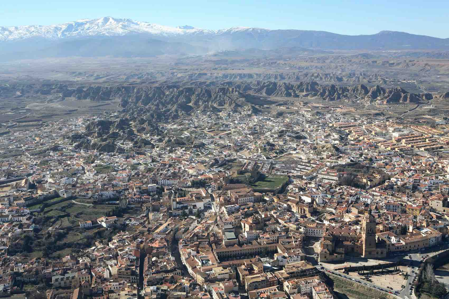 Panorama of Guadix and Sierra Nevada in the background. The city lies at an altitude of 913 metres