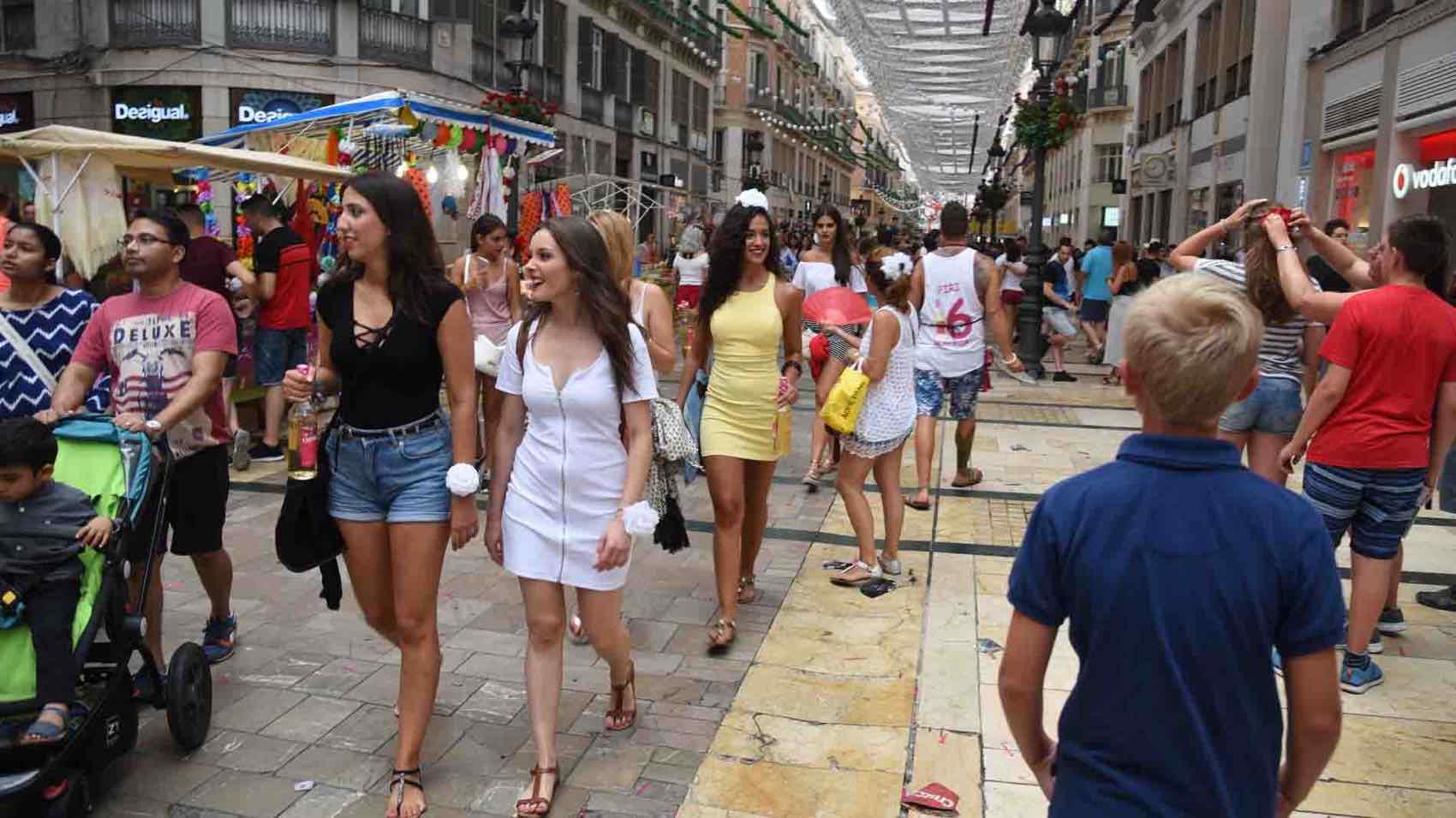 The beautiful people walks the elegant street of Calle Larios in Malaga