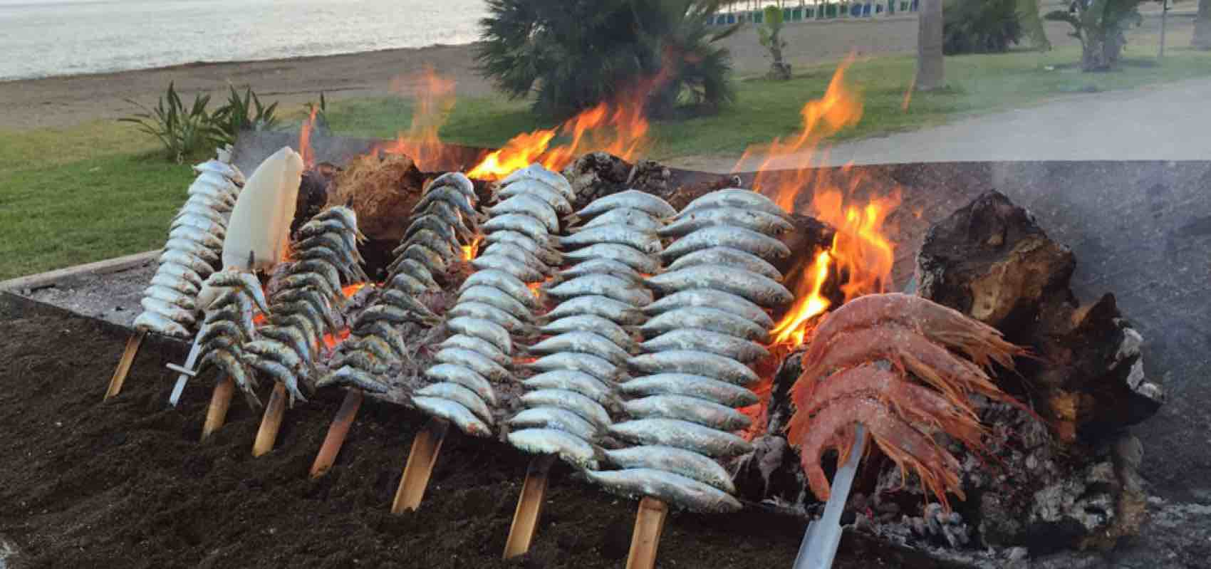 Fresh sardines grilled on the beach - a local speciality of Malaga