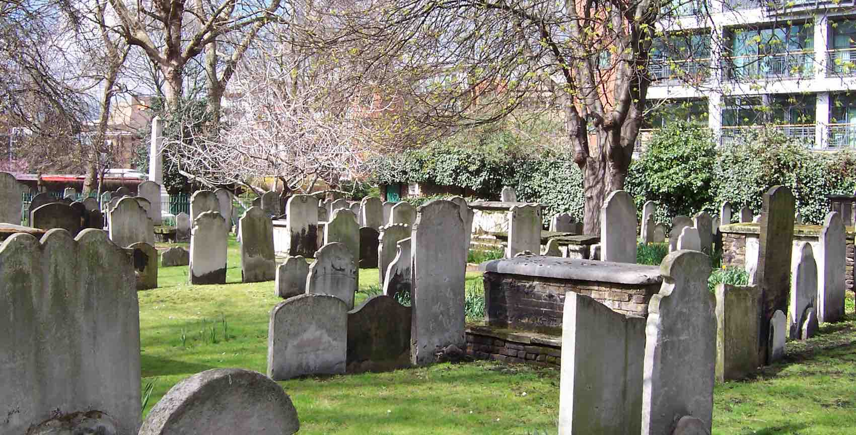 Old graves and gravestones at Bunhill Fields Burial Ground in central part of London