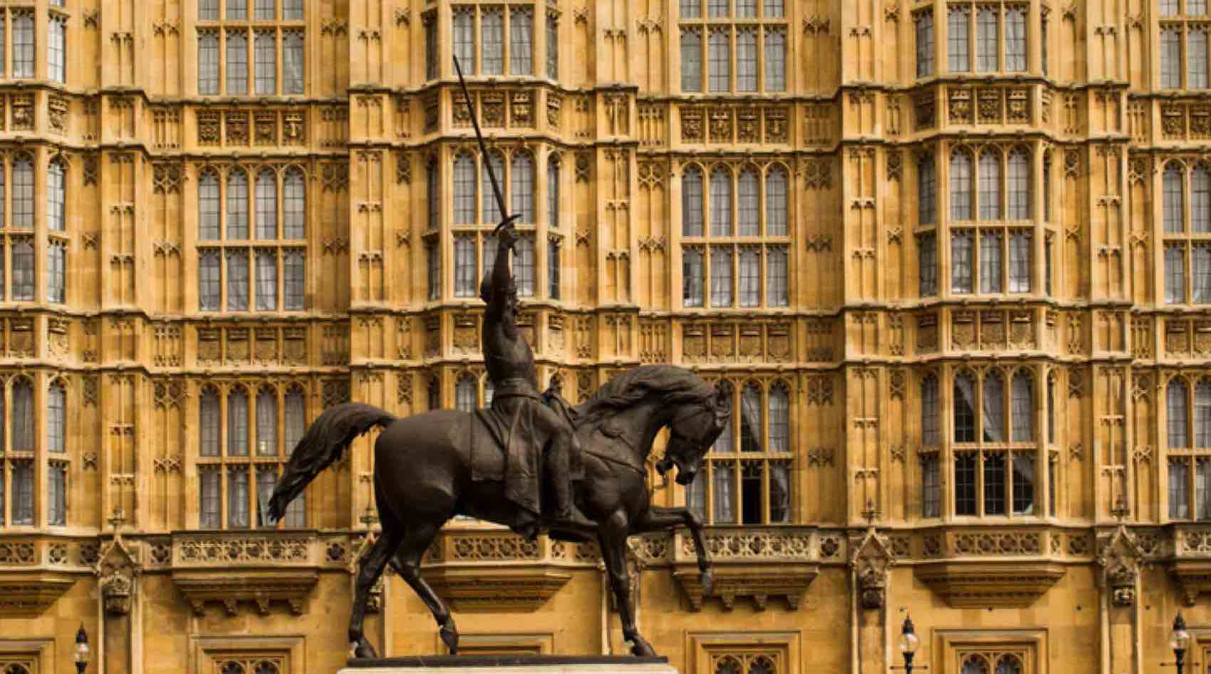 Statue of King Richard the Lionheart, the crusader king outside the Houses of Parliament, Westminster. Seated on his horse with his sword drawn.