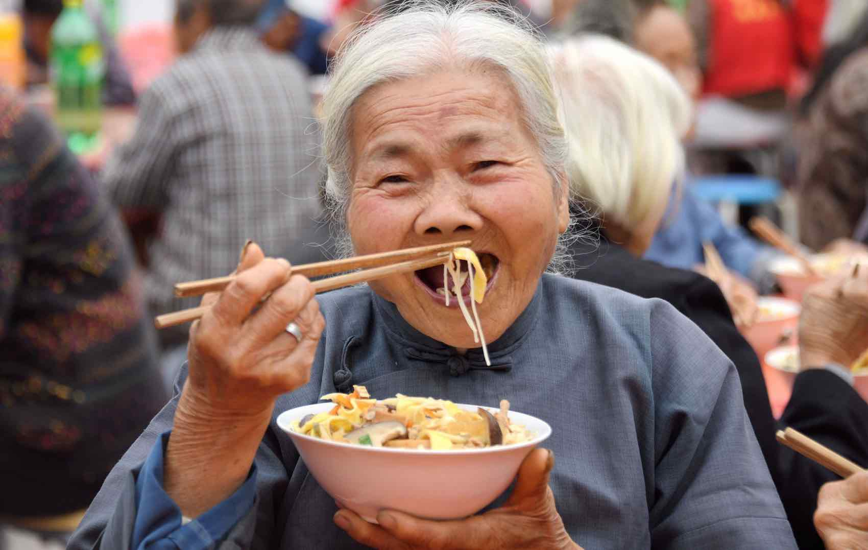 """Chinese celebrate """"Long Noodles"""" for a long life to come. And they are eating noodles"""